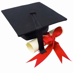 Close up of a graduation cap and a certificate with a ribbon --- Image by © Royalty-Free/Corbis